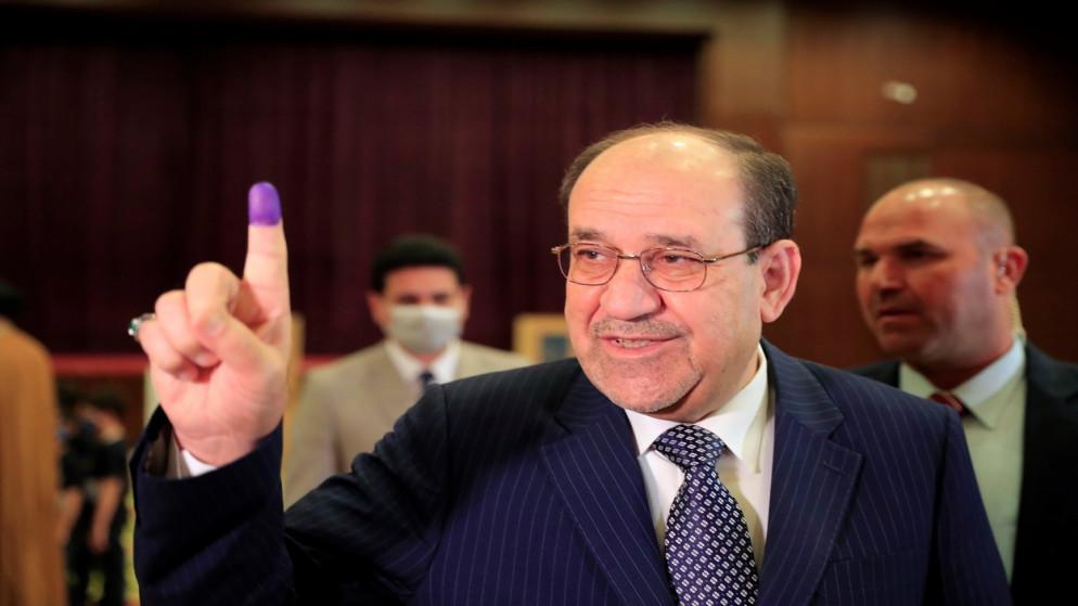رئيس الوزراء العراقي الأسبق نوري المالكي بمركز اقتراع في بغداد. (رويترز)